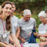 happy-volunteer-looking-at-donation-min